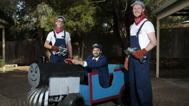 Thomas the billy cart: (from left) Aaron Dixon of Braddon, Dimitri Markakis of Belconnen and Mitchell Searle of Belconnen with their two-seater Billy Cart that they built over two months from a quad bike chassis.