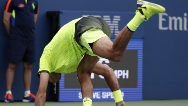 Juan Martin del Potro, of Argentina, loses his balance after a shot to David Ferrer, of Spain, during the third round of the U.S. Open tennis tournament, Saturday, Sept. 3, 2016, in New York. (AP Photo/Kathy Willens)