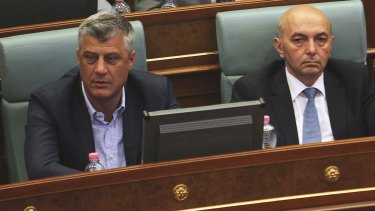 Kosovo's Prime Minister Isa Mustafa, right, next to deputy prime minister and foreign minister Hashim Thaci, in parliament, in Pristina, Kosovo, on Monday.