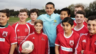 Where it all started:  Socceroos star Tim Cahill visited former junior club Marrickville Red Devils at Mackey Park on Tuesday.