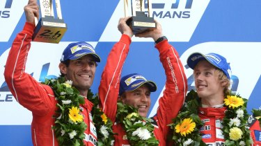 Australian Mark Webber, German Timo Bernhard and  New Zealander Brendon Hartley celebrate claiming second place at Le Mans for Porsche.