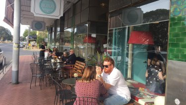People enjoying an early morning coffee at the trendy cafes along Whatley Crescent, Maylands.