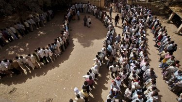 Unemployed Indians stand in a queue to register at the Employment Exchange Office in Allahabad in 2012.