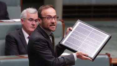 Adam Bandt brandishes a solar panel during question time earlier this year.