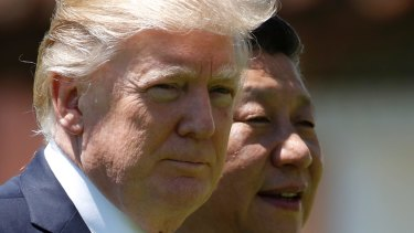US President Donald Trump and Chinese President Xi Jinping walk together at Mar-a-Lago in Palm Beach, Florida in Apeil.