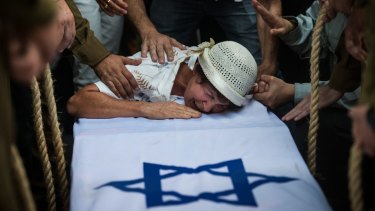 Amnesty report: The grandmother of Israeli soldier Jordan Bensimon at his funeral on July 22, 2014 in the southern Israeli city of Ashkelon.