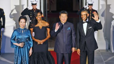 President Barack Obama, right, and Chinese President Xi Jinping, second from right, with wives Peng Liyuan, left, and first lady Michelle Obama as they arrive for a state dinner at the White House.