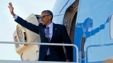 President Barack Obama boards Air Force One on the last day before Americans vote to replace him in the Oval Office.