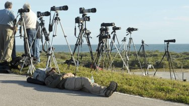 Rest up: A news photographer awaits the launch of The Delta IV Heavy rocket with the Orion spacecraft from Cape Canaveral.