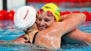 Rivalry: Emily Seebohm hugs Missy Franklin after competing in the women's 100m backstroke heats at the World Championships in August 2015.