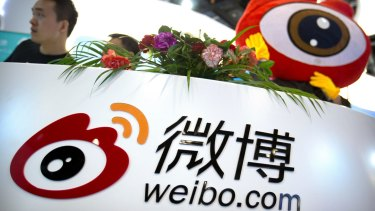 Staff members at a booth for Chinese microblogging website Sina Weibo at a conference in Beijing. Three popular Chinese internet services, including Sina Weibo, have been ordered to stop streaming video after censors complained they provided improper content