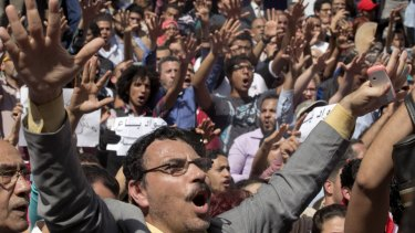Egyptians shout slogans against Egyptian President Abdel-Fattah al-Sisi after the handover  of two Red Sea islands to Saudi Arabia.
