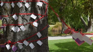 Messages are left on a tree after a memorial service held on Monday in Christchurch's Botanical Gardens for victims of the 2011 earthquake.