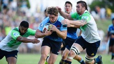 Thrills: NSW breakaway Michael Hooper breaks through the Highlanders defensive line.