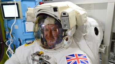 European Space Agency astronaut Tim Peake, of Britain, during the final fit check of his spacesuit before his International Space Station spacewalk.