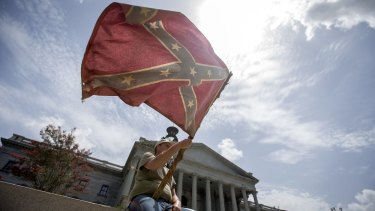 John McCaskill waves a Confederate battle flag he has owned for three decades, on the steps of the State House in Columbia, South Carolina, July 9, 2015. After hours of emotional debate, legislators voted early that day to stop flying the flag on the grounds of the State Capitol.
