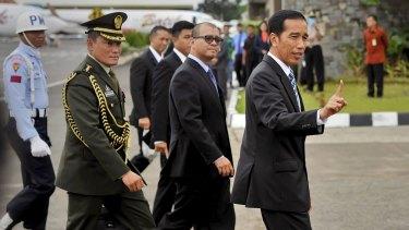 Indonesian President Joko Widodo, right, returns from the ASEAN summit in Malaysia on Monday.