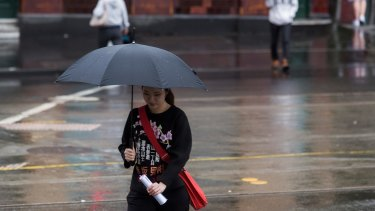 Rain was easing in the city on Saturday.