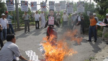 South Korean conservative protesters burn a effigy of North Korean leader Kim Jong-Un and flag during a anti-North Korea rally near the demilitarised zone at Imjingak on Tuesday.
