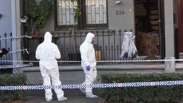 Police officers at the scene of a raid in Surry Hills, Sydney.