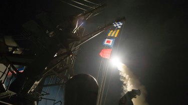 The USS Ross fires a Tomahawk missile at Syria from the Mediterranean Sea.