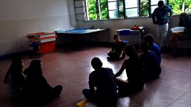 Students hold a class at the occupied state high school Lyceu de Goiania in Goiana, Brasil.