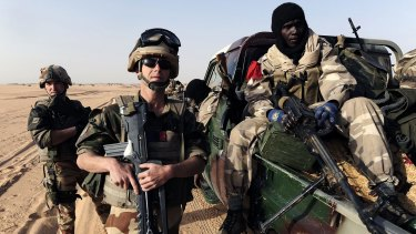 French soldiers speak with a Malian soldier in 2013 in Bourem, northern Mali.