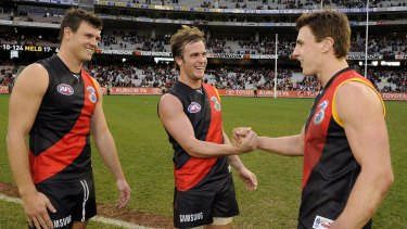 Matthew Lloyd with former Essendon teammates Andrew Welsh (centre) and David Hille in 2008.