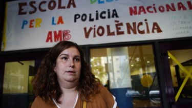 School teacher Elisa Aroca stands in front of the Estel School in central Barcelona, where National Police confiscated ballot boxes during the referendum voting.