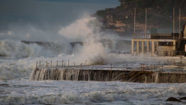 Waves crash against Bondi Icebergs on Monday.