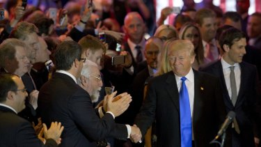 Donald Trump greets supporters in New York.