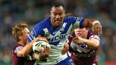 Unleashed: Tony Williams charges through the Manly defence.