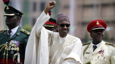 Nigerian President Muhammadu Buhari salutes his supporters during his Inauguration in Abuja, Nigeria, in May.