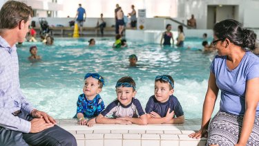 Justin Scarr of Royal Life Saving with Fiji delegate Devina Nand visit Ian Thorpe Pool in Sydney as part of an international delegation visiting Australia to learn about drowning prevention. Scarr is pictured with three-year-old Jacob Wright and six-year-old twins Joey and Ben of Pyrmont.