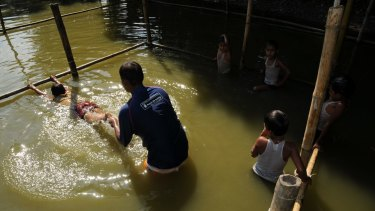 Swimming lessons in Bangladesh.