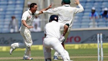 Breakthrough: Steve O'Keefe celebrates the wicket of Virat Kohli.