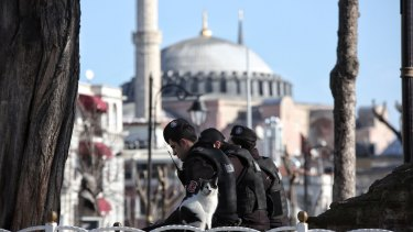 Turkish police attend the site of an explosion in the central Istanbul Sultanahmet district on January 12.