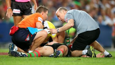 Down and out: Souths forward Dave Tyrrell is treated following a head clash with James Graham.