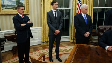 Jared Kushner, flanked by National Security Adviser Michael Flynn (left) and US Vice-President Mike Pence, watches his father-in-law Donald Trump sign his first executive order as US President.