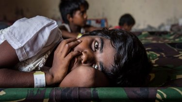 A Rohingya girl resting at a temporary refugee shelter in Aceh, Indonesia, in May.