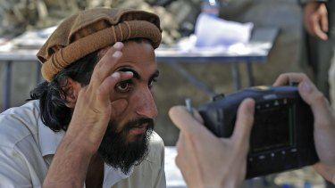 An Afghan man has his eye scanned for identification in Nangarhar province, bordering Pakistan.