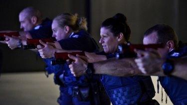 Victoria Police recruits in the firearms training simulator.