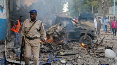 A Somali soldier near the wreckage of vehicles after the October 28 attack in Mogadishu.