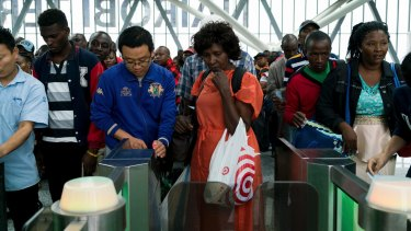 Chinese employees helped passengers to scan their tickets at the new Standard Gauge Railway terminal in Nairobi, Kenya.