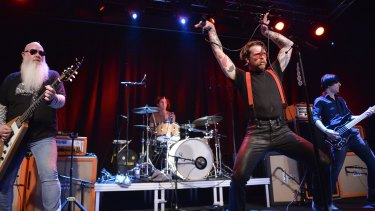 Singer Jesse Hughes of Eagles of Death Metal says the band is committed to finishing the Paris show that was stopped when Islamists killed 89 people during a terrorist attack at the Bataclan Theatre.