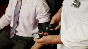 Primary prevention: A GP takes a patient's blood pressure.