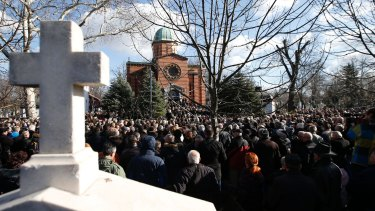 A huge crowd attends the funeral of Kosovo Serb politician Oliver Ivanovic.