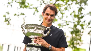 Roger that: Roger Federer with the trophy on Monday.
