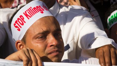 A Rohingya man living in Malaysia cries during a December 4 protest in Kuala Lumpur against the persecution of Rohingyas in Myanmar.