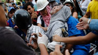 A demonstrator wounded during clashes with security forces in Caracas this week.
